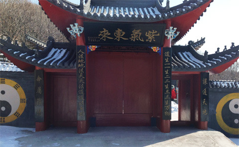 Photo by Alec Ash, Wulong Mountain, Liaoning Province, February 2013. Travels in China: A Brief Encounter with a Mountain Mystic  by Alec Ash  The Taoist priest looked at me askance and guessed correctly that I was British. I was in his temple three days before the Chinese new year, following a friend from the area who was there to light incense and drop money into the collection box for good luck in the year ahead. The red-faced deity guarding the box stroked his meter-long beard and accepted the bribe. We were halfway up Wulong mountain outside Dandong in northeastern China, 16 kilometers from the North Korean border. A golden Buddhist temple higher up the hillside overshadowed its more humble Taoist brother, with low grey walls and a roofed red gate. Stenciled outside the entrance, two yin-yangs for punctuation, was 人能弘道 非到弘人  Man can enlarge the Way; the Way cannot enlarge Man. Inside was a courtyard, a bronze censer for burning incense, a cramped shrine room, living quarters with kitchen, and a five-foot-nothing priest with a square chunk of jade tied to the front of his cap that looked heavier than him. As soon as my nationality was uncovered, the priest ushered me into a back room and beckoned for me to sit on a stool, while he parked himself behind an oversized wooden desk and gathered scraps of blank paper around him. I had the creeping feeling that whatever Taoist magic I was going to witness was going to cost me something more material. What astrological year do you belong to? the priest asked me in Chinese, picking up a Biro pen and scribbling his prediction on a scrap. The ox, I said. The priest crumpled up the paper he had written on, and threw it to one side. How many brothers or sisters do you have? he asked, writing a number. I have one older brother. The priest hesitated for a long second. Then he showed me his scrap, the number two on it. Including you, there are two brothers. Sorcery. There were truly more things in heaven and earth than dreamed of in my philosophy. What floor of your building do you live on? he asked, scribbling again, spurred on by his success. The third floor. He had written the number three. Alright, that one was kind of impressive. How old is your mother? I told him my mothers age. He had gotten it wrong by three years, but sportingly he showed me his scrap anyway with a shrug of his shoulders, as if to say: meh, two out of four. Having established his credentials so convincingly, we got to the advice portion of the session. When you choose a woman, he began, you must remember three things. Lady tips. Always useful. Number one: she should be Chinese. Thats curious, I had been told the same thing by my landlady not two weeks ago. In fact, there was someone I had my eye on, and she was Chinese-born. He had my ear. Number two: she should be born in the year of the rat or the dragon. I did a quick calculation from the birthday of my romantic interest. Dragon. Score. She should definitely not be born in the year of the tiger, sheep or horse. Mental note filed and stored. Number two: her nose should be like this  he made an indecipherable swoop of his hand over his nose  and not like this  another swoop in the opposite direction. I asked for clarification. The tip of the nose, he explained more patiently, should point up rather than curve down. He even drew me a helpful diagram of correct and incorrect noses, with slit-shaped eyes above them, presumably to reinforce the first point. Also, the eyebrows should be high, the cheeks should be low, and she should not have hair on her upper lip. I would have to check all this when I got back to Beijing (or back on Facebook). But I was relieved that I was not destined to marry a mustachioed woman. I looked to the priest, feeling that perhaps he had a final word of wisdom to impart. But the Way is mysterious, the priest was silent, and my last commune with the unfathomable enigmas of Tao was indeed related to female upper lip hair.