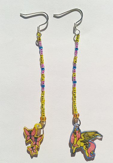 Earrings featuring fluttershy from MLP: FiM.  If you are interested in seeing more pictures or perhaps even buying it you can visit it here!
