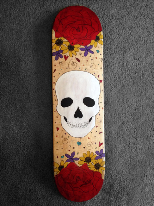 in progress skateboard, still needs the sugar skull finishes and a coat of resin. it will be available for sale once completed, email me if interested.