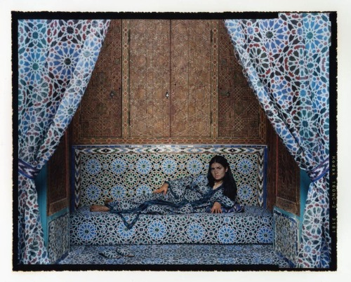 Lalla Essaydi Lalla Essaydi (Moroccan, b.1956) is a painter and photographer. Her work focuses on the Arab female identity in a 19th-century Orientalist style. She is well-known for hand-drawn Arabic calligraphy paintings done with henna on different types of surfaces, such as fabric, bodies, and even walls. Her style reflects her training and expertise in constructing intricately set Figurative compositions. Inspired by 19th-century Orientalist works, Essaydi is known for paintings that combine Islamic calligraphy and representations of the female body with Western painting traditions. She frequently addresses the complexities of female identity in the Arab traditions from a personal perspective. Her works are a reflection of her Moroccan girlhood, depicting a woman caught between the past and the present. Her paintings explore Orientalist mythology through imagery from a Modernist point of view.