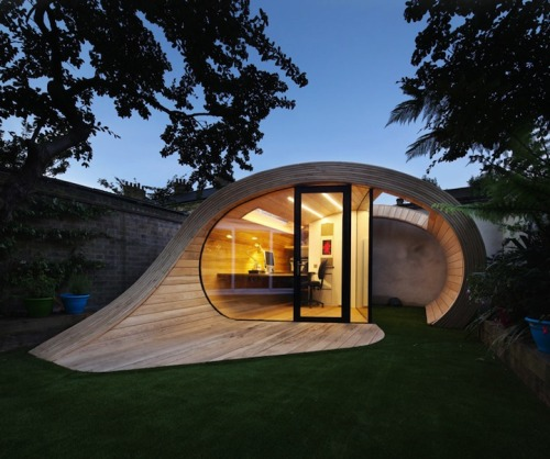 "Shoffice (Shed + Office) is a design developed by London-based firm Platform 5 Architects. The structure, shaped like a cresting wave, is located in the backyard of a 1950's terraced house in St. John's Wood. The timber shape was designed as a reflection of a wood shaving, which fits well into the natural surroundings, and it curls around to form a small terrace in front of the enclosed building. The firm says that the intentions for the project were to create ""a sculptural object that flowed into the garden space. Shoffice by http://platform5architects.com/"