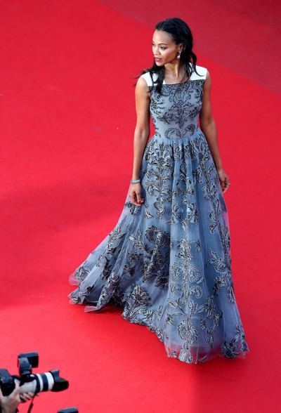Zoe Saldana enchants on the red carpet in a flower embroidery and tulle Valentino gown at the premiere of her latest movie, 'Blood Ties', during the 66th Cannes Film Festival held at the Palais des Festivals in France yesterday. Her gown is from the Valentino Fall Winter 13/14 Collection, created to express a fragile sensuality and inspired by Flemish painters