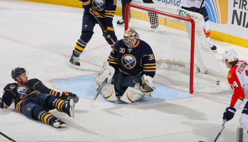 """ BUFFALO, NY - FEBRUARY 03: Ryan Miller #30 of the Buffalo Sabres makes a stop as Alexander Sulzer #52 of the Buffalo Sabres and Tomas Fleischmann #14 of the Florida Panthers look on at First Niagara Center on February 3, 2013 in Buffalo, New York.""   …is that not the puck in the net?"