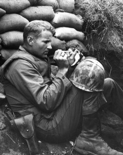 If you were having a bad day, here's a picture of a Marine feeding canned milk via medicine dropper to an orphaned kitten during the Korean War.