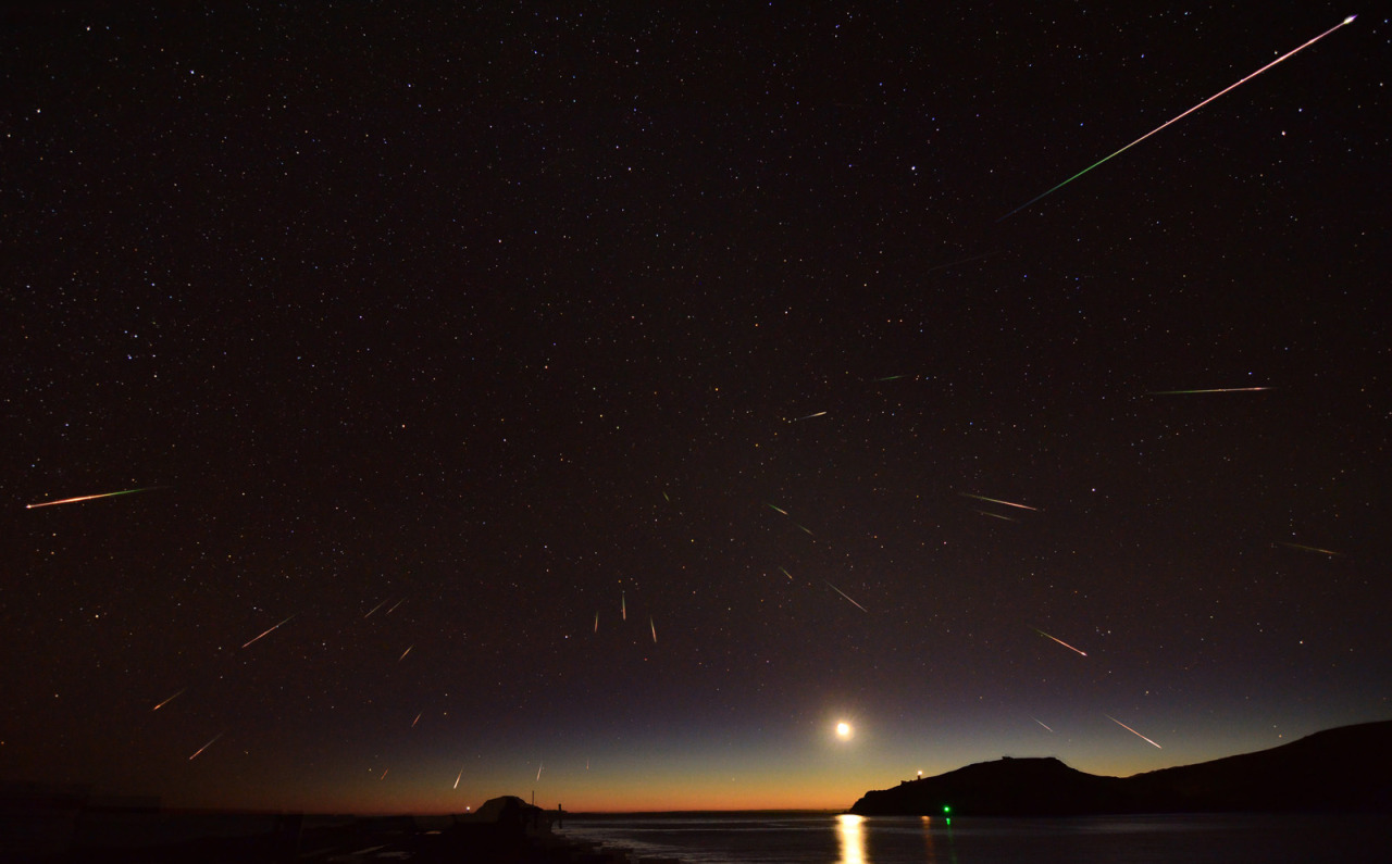 Eta Aquarid meteors over New Zealand this week, photographed by Stephen Voss over the course of 90 minutes. Every spring, Earth crosses the orbital trail of Halley's Comet. While we'll have to wait until 2061 to see the actual comet again (I am old enough to remember seeing it back in 1986, though, so nah!), each year we get a fresh sprinkling of comet tail dust into our atmosphere at 150,000 mph. As Earth whips through, the debris appears to radiate out from the constellation Aquarius, which is evident in the photo above. It's a coincidence, but a beautiful one. Read more about the Eta Aquarids at EarthSky and Bad Astronomy.