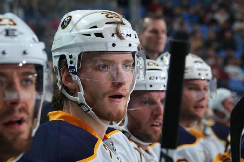 Mikahil Grigorenko on the bench during Monday night's scrimmage