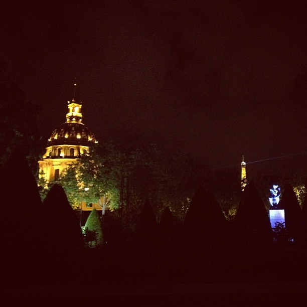 Les Invalides and the Eiffel Tower last night seen from the garden of the Rodin Museum in Paris, France
