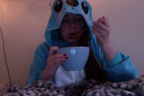 eating tomato soup in my early birthday present koala onesie.