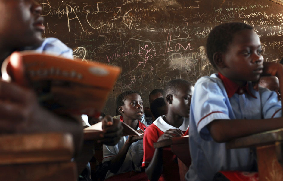 Students attend a lesson at a public school in Gudele, on the outskirts of South Sudan's capital Juba on April 8, 2013. [Credit : Andreea Campeanu/Reuters]