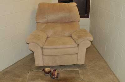 What fun to sit in a comfortable chair and watch TV and movies —- shackled to the floor.   (via 3 Pictures That Tell You Everything You Need to Know About Guantanamo | Alternet)