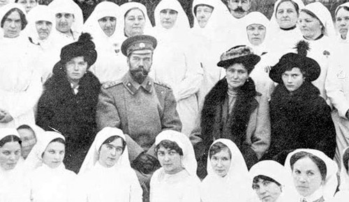 Grand Duchess Olga, Nicholas II, Alexandra Feodorovna, and Grand Duchess Tatiana visiting Sisters of Mercy at a hospital c. 1915.