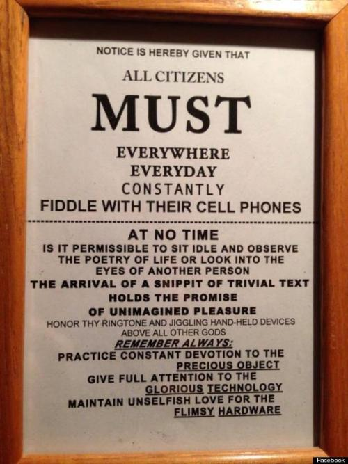 "huffpostcomedy:  ""All Citizens Must Fiddle With Their Cell Phones"" Sign Should Be Posted In Every Public Place"