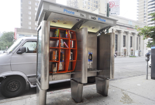 NYC Phone Booths Turned Into Free Mini Libraries When was the last time you used a phone booth? Despite cell phones being as common as clothing, rarely-used metal phones booths still exist throughout New York City, but architect John Locke has created a clever way to give them new life. Locke attached a pumpkin-orange set of shelves to an obsolete phone booth near 96th Street to create a mini, ultra-public library. Click here for more photos!
