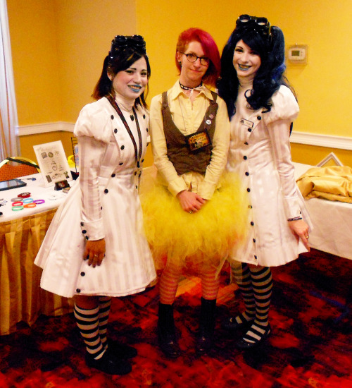 Friday May 17th @ the Steampunk World's Fair  wherein I met the Walter girls! :D  other notes about Friday: a bunch of folks complimented my tutu, which I made myself, so I was happy and proud that people loved it. :3 I was all soft femme on Friday. this was supposed to be my steampunk Fluttershy cosplay, but I had a handful of costume mishaps (the wig got tangled and I lost my wig cap, then the ears I made were too big to wear without the wig, and I didn't have time to make the wings, lol) so it wound up not being that recognizable but oh well… imnsho I was still adorable!  the tutu is shorter and yellow in the front and pink and long in the back, fyi… you just can't see that in this pic.