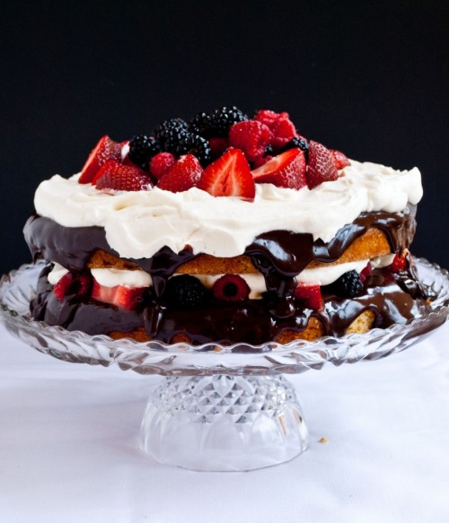 gluten-free coconut cake with chocolate ganache, berries, and cream.