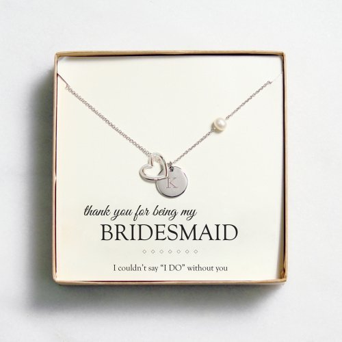 This beautiful open heart medallion necklace is a great way to share the love with all the special ladies in your life. Each necklace comes with your choice of five special message cards. For a gift they are sure to treasure for years to come, present each bridesmaid with a necklace on the big day, at the rehearsal dinner, or during the bridal shower. The perfect way to say thanks for standing by your side on your big day, this necklace makes a beautiful finishin