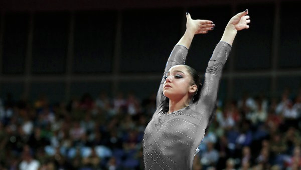Leotard lovers: please to have this image of Mustafina with a transparent-fied version of her navy leotard from London. (No, seriously you guys. It's transparent. Just reblog, or click and drag. :] )