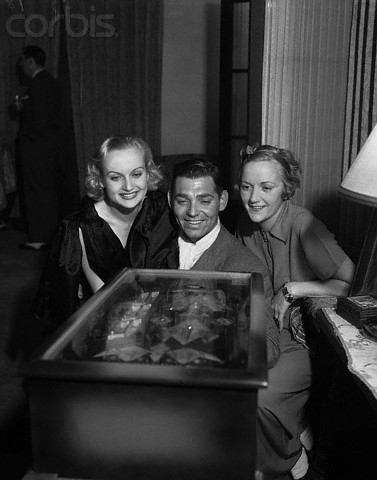 Carole Lombard and Clark Gable with a friend.