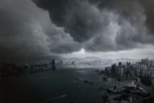 Today in Hong Kong A really spectacular image … those clouds looks rather portentous and the way the light is breaking through at the heart of the frame seems almost apocalyptic. It was taken over Victoria harbour in Hong Kong, in case you're wondering. Photograph: Philippe Lorez/AFP/Getty Images