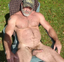 "dadsonluv:  After mowing the lawn, dad took off all his clothes and laid in a lawn chair saying it was too hot to do anything else.  He sent me in the house to fetch a beer for him.  When I came back out he was playing with himself getting a hard on.  ""Thanks for the beer, son, now kneel between daddy's legs.  Your refreshment's in my balls and you need to work on getting it out."