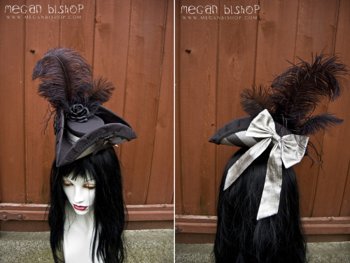 auris-cosplay:   Black x Silver Tricorn  Custom black and silver tricorn. Black silk, silver silk band and bow, with black and silver striped underlayer. Trimmed with black satin ribbon, black millinery rose, huge silver bow (in the back), and hand curled ostrich feathers of varying types and lengths. Made by Megan