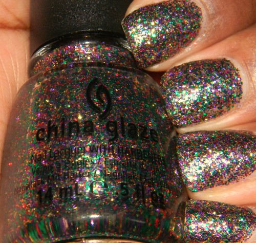 China Glaze - Glitter All The Way from the 2012 Holiday Joy Collection Glitter All The Way consists of multi sized gold, green, red, and purple glitter in a clear base. Other than the name, I wouldn't consider this a Winter polish. It's like Mardi Gras on my nails. I will definitely be wearing this year round. Fin.