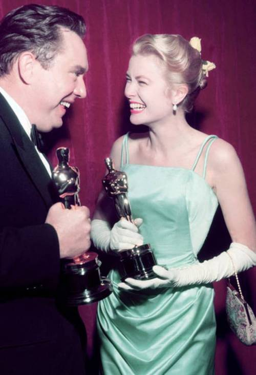 Grace Kelly and Edmond O'Brien holding their Oscars - hers for The Country Girl (Best Actress), and his for The Barefoot Contessa (Best Supporting Actor).