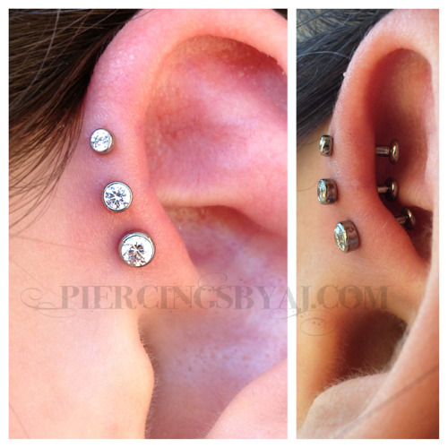piercingsbyaj:  Fresh 16g triple forward helix with 2mm, 2.5mm, and 3mm bezel set white CZs. Titanium jewelry from Industrial Strength.  another beauty from AJ.