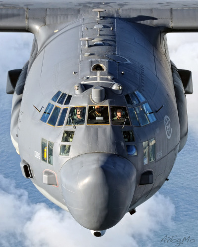 #lockheed, #c130, #mc130, #us_air_force, #grey, #detail, #pilot, #flying, #top_front_view, #over_sea, #over_clouds, #military_transport_aircraft