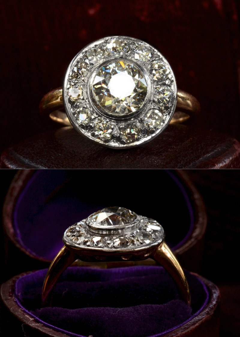 1920s Daisy/Cluster Ring 1.18ct European Cut Diamond (I-J SI1) Center~0.77ctw Transitional & European Cut Diamond Sides (G-H SI2-I1)Platinum and 14K Gold, $9350