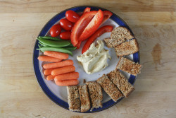 "runningfearless:  Toasted Ezekiel bread ""soldiers"", baby carrots, sugar snap peas, grape tomatoes, bell pepper and plenty of hummus to dip."