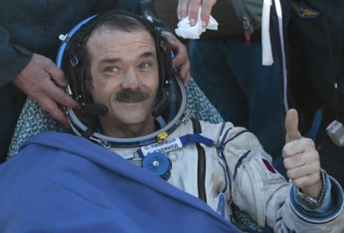 guardian:  The Starman falls to earth. Canadian astronaut Chris Hadfield, whose David Bowie cover captured the imagination of Earthlings yesterday, landed safely Tuesday on the steppes of Kazakhstan. Photograph: Mikhail Metzel/AFP/Getty Images