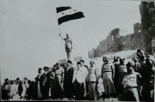 Raising the Independence Flag at the Citadel in Aleppo, Syria in 1946. It will be raised again over the Citadel soon …  Thanks @tweets4peace