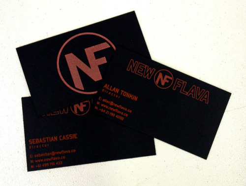 2/2 screen printed business card. custom duplexed 200lb. epic black neenah paper. i love how BLACK this paper is compared to the other blacks we run into. there is a hit of glow in the dark ink over the logo on the front and the top NEW flava text/logo.