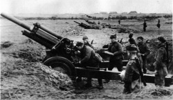 Battery of Soviet 122 mm howitzers firing on Berlin.