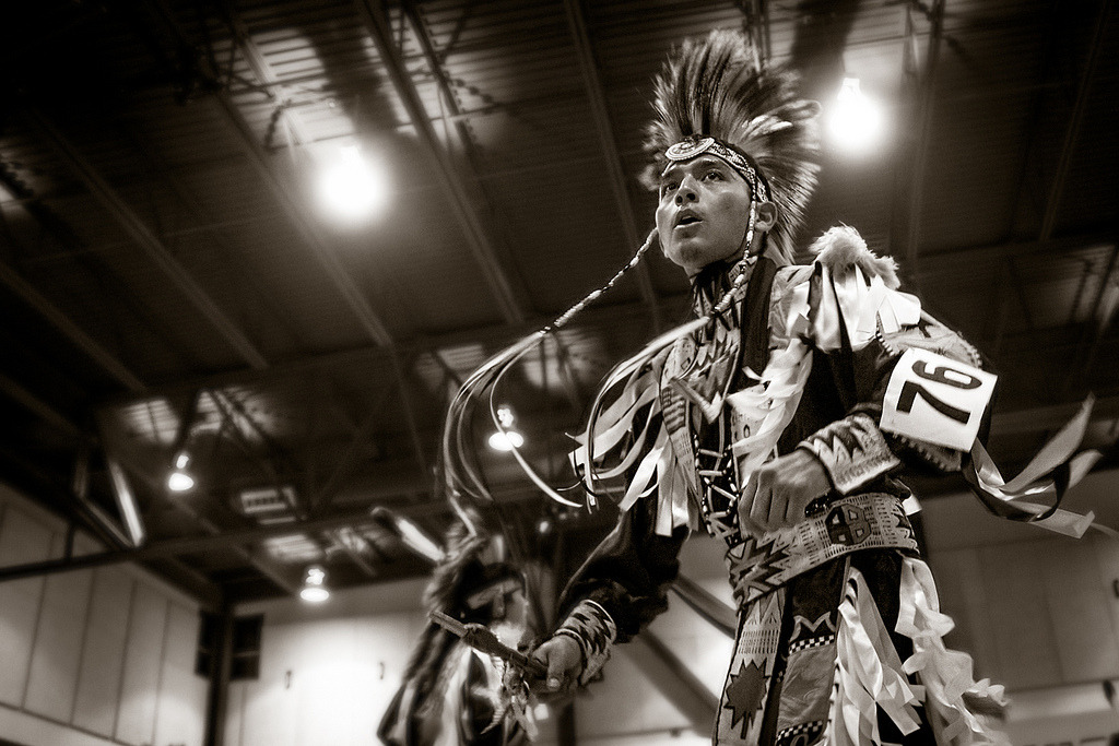 A Grass Dancer briefly looks at the crowd during UNM-Gallup Native American Club's fall Pow Wow 2012 in Gallup, New Mexico.