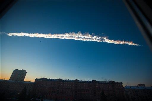 Meteor warning system in the works, but far from ready (Photo: Yekaterina Pustynnikova / AP) There aren't yet any advance warning systems that could give Earthlings a heads-up before an untracked space rock hits. But a telescope project in Hawaii aims to change that, and potentially provide a chance for those in threatened areas to evacuate. Read the complete story.
