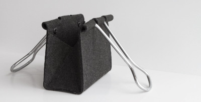 Clip Bag by Peter Bristol Constructed of wool felt and aluminum tubing.