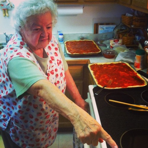Nona bossing me around the kitchen as we make pizza.