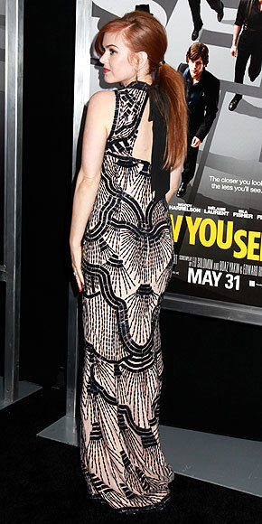 Better From The Back? Isla Fisher She's not promoting The Great Gatsby, but that doesn't stop the actress from channeling the film's glam retro wardrobe in a 1920s-inspired beaded gown at the Now You See Me premiere. See the look from all angles here!