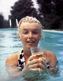 Marilyn swimming in photographer, Milton Greene's Hollywood pool.