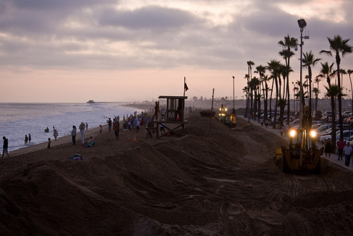 Making a wall of sand by Capt. Hops on Flickr.Newport Beach, CA