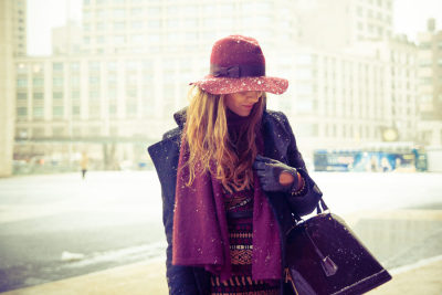 Braving the blizzard in stunning shades of purple…Chelsea, NYC (via Racked)