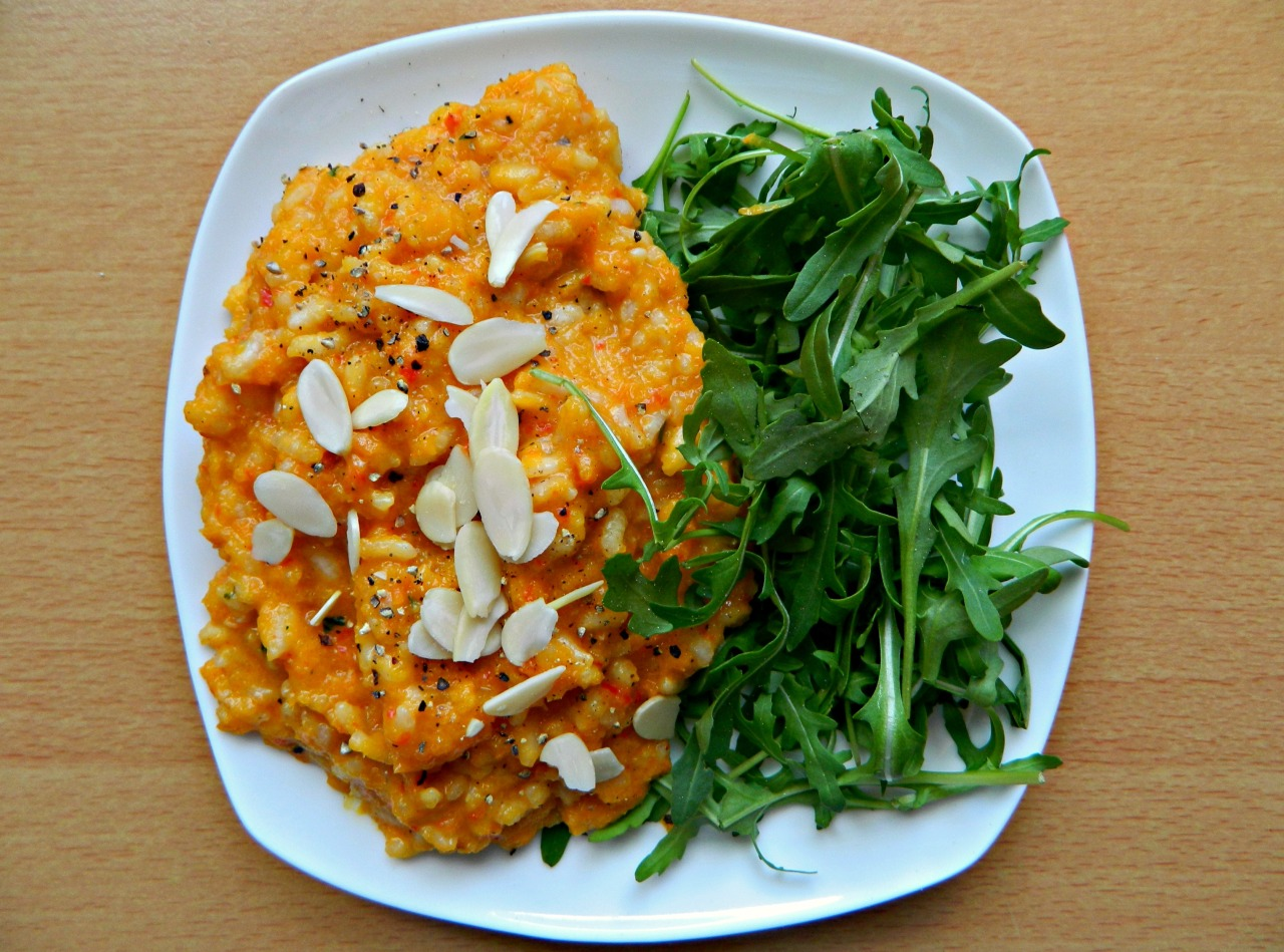 Butternut squash risotto with flaked almonds and rocket. (gf, vegan) I've never attempted risotto before as I was told it was incredibly difficult to do, but considering I completely made this recipe up and it was the bomb.com, it can't be that difficult! :P I roasted some b-squash, a carrot and some red bell pepper together in coconut oil, paprika, tarragon and s&p, then blended with almond milk, apple cider vinegar and nutritional yeast (in place of parmesan). I boiled the arborio rice separately with vegetable stock and a little garlic, adding a dash of almond milk at the end, then poured the purée/sauce over the rice and munched away. :3 I made waaay too much rice (on purpose) but I made 3 cups stock to 1 cup rice, added 1 cup stock to the rice in the pan and simmered until absorbed, then poured a little stock in at a time, waiting until that bit had absorbed before adding the next bit until every last bit was gone. And that's your basic risotto! :)