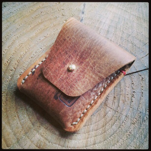 A coin purse with a card pocket on the reverse. Made from a ww1 army satchel.