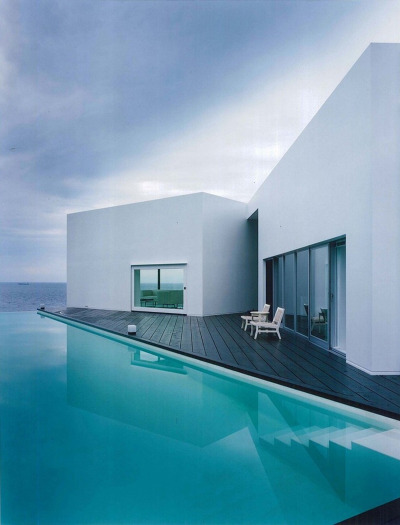 Oceanfront home and pool by architectural firm ANDO Corporation. House located in Wakayama, Japan.