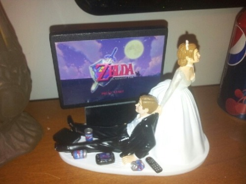 Someone had a brilliant idea for a wedding cake topper.