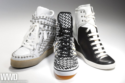 womensweardaily:  Sneakers Wedge In The high-flying sneaker wedge shows no signs of coming down for fall '13.  More than a year after Isabel Marant launched her Willow style, which was hugely successful from the start, that shoe is still selling out at retail. And now labels at every other price point, from Prada to Candie's, are also cashing in with their own takes on sneaker wedges. For More [above from left: Styles by Ash, Adidas Originals and See by Chloe]  Hmm