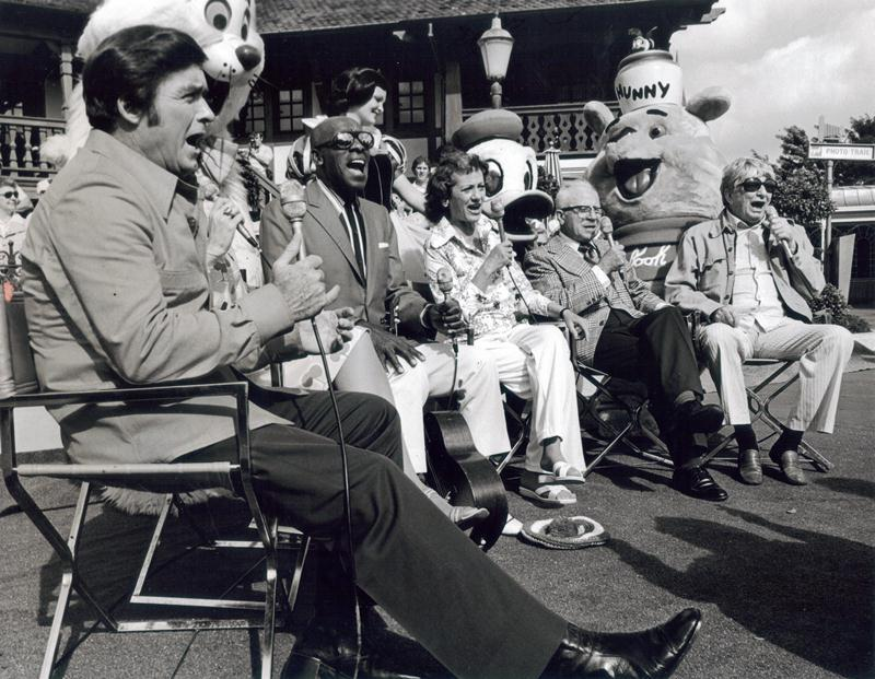 VOICES OF PAST Disney motion pictures are reunited with TV host Mike Douglas, left, during videotaping of Mike Douglas Show at Walt Disney World. Others pictured are from left, Scatman Crothers, the voice of Scat Cat in the Aristocats; Adriana Caselotti, the voice of Snow White; Clarence Nash, voice of Donald Duck; and Sterling Holloway, voice of Winnnie the Pooh and other characters. Behind each guest is the famed Disney character as it appears today. Mike, himself, was the singing voice of Prince Charming in the movie Cinderella. Five 90-minute shows were being taped during the week of January 26 for national telecast in February.