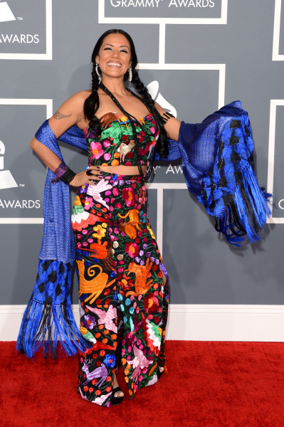 And the worst-dressed celebrity at the Grammy Awards is… Lila Downs! I wish there was some big-name star who completely bombed on the carpet, but like I said earlier, this year was less-than-exciting. So this'll have to do as the token atrocious getup. Honorable Mentions: Keltie Colleen Alexa Chung in Red Valentino Ashanti in Tony Ward Couture Esperanza Spalding Taylor Swift in J. Mendel (just because it was another. White. Dress.)
